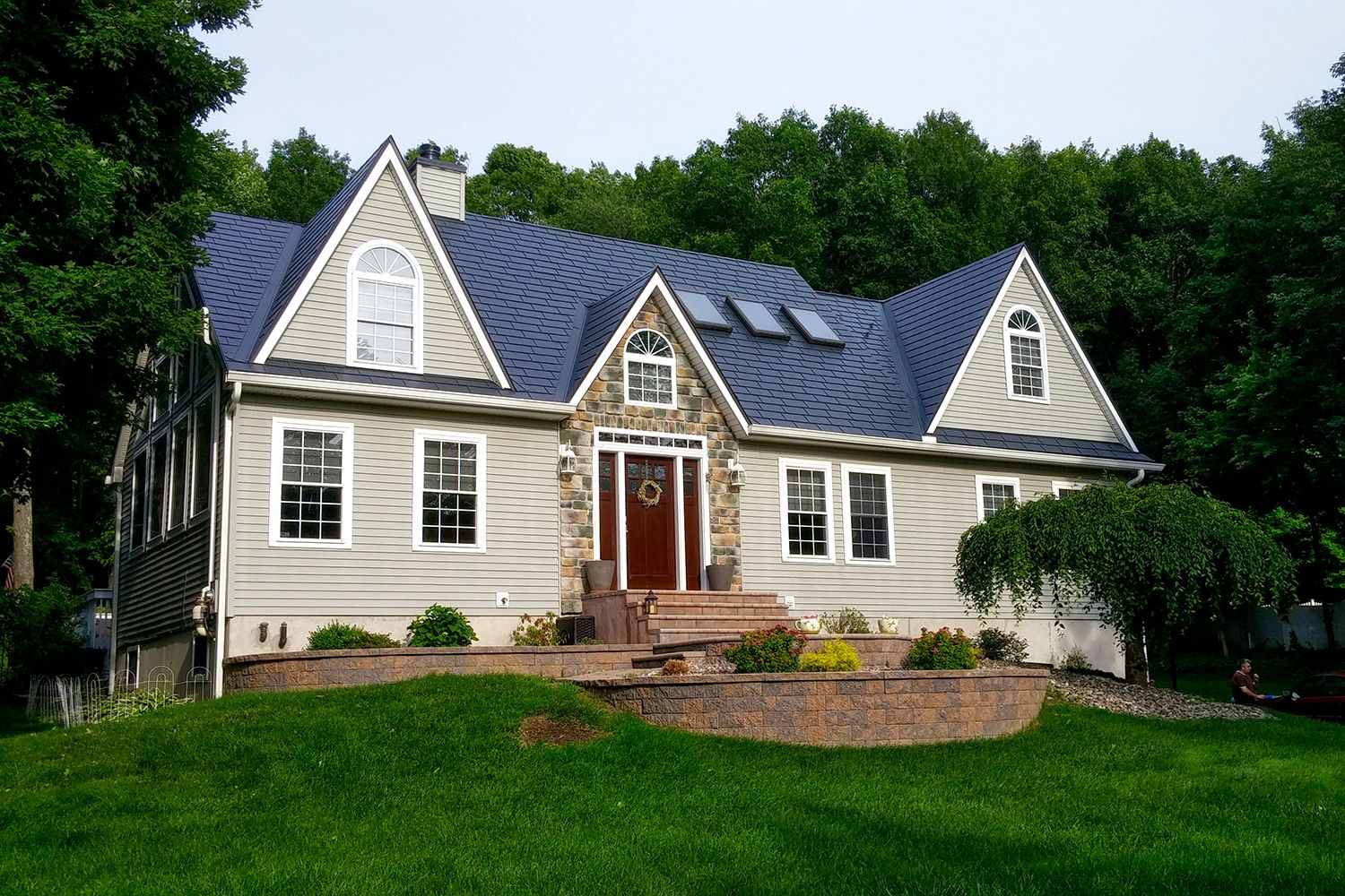 black metal slate roof dormers skylights stone