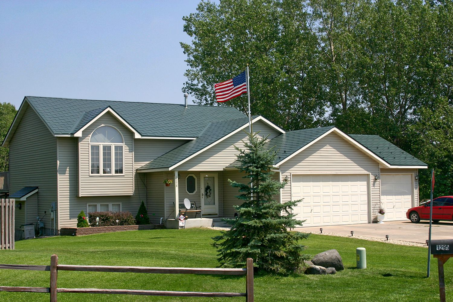 green metal slate roof hip gable american flag