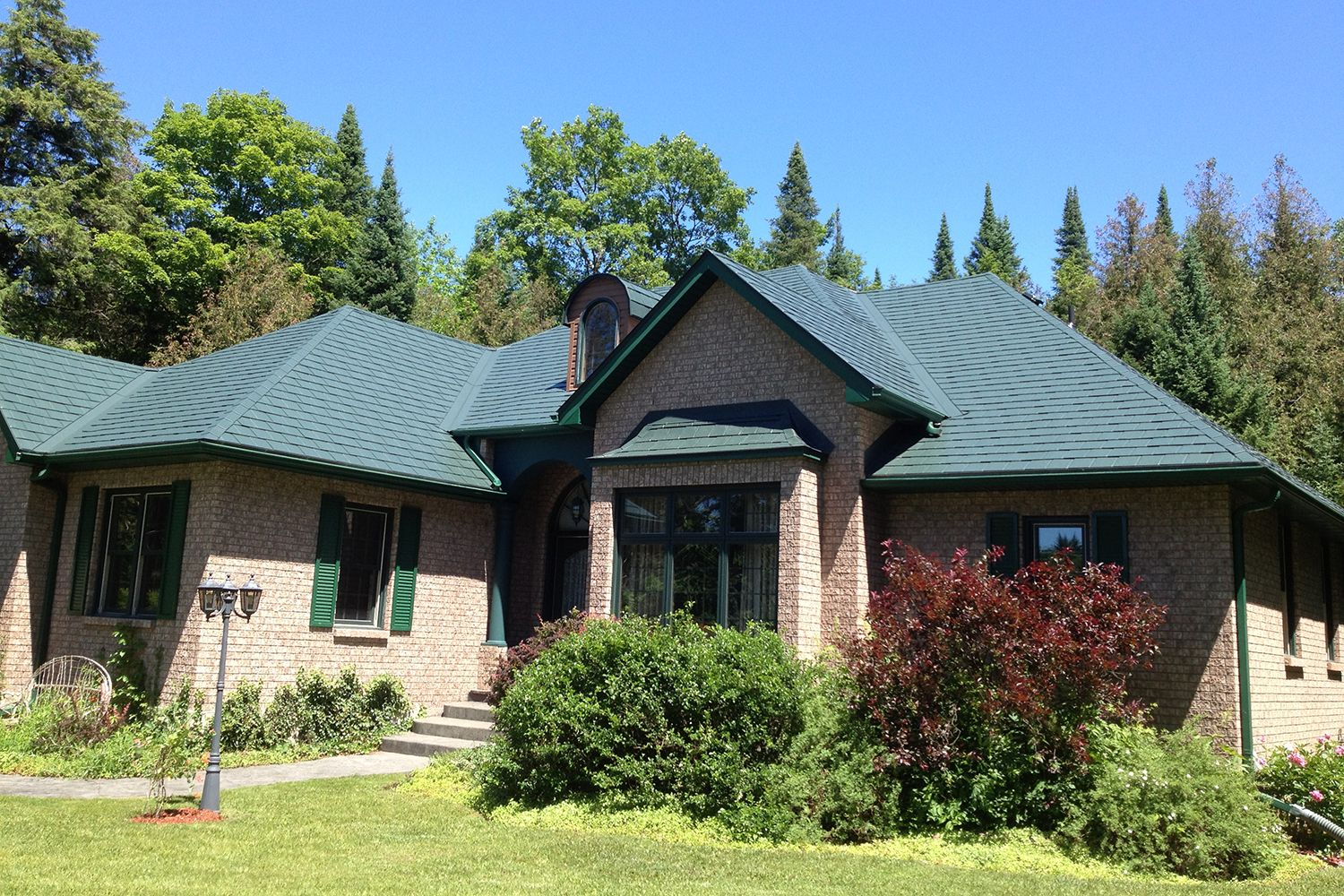 green metal slate roof hip valley dormers shutters