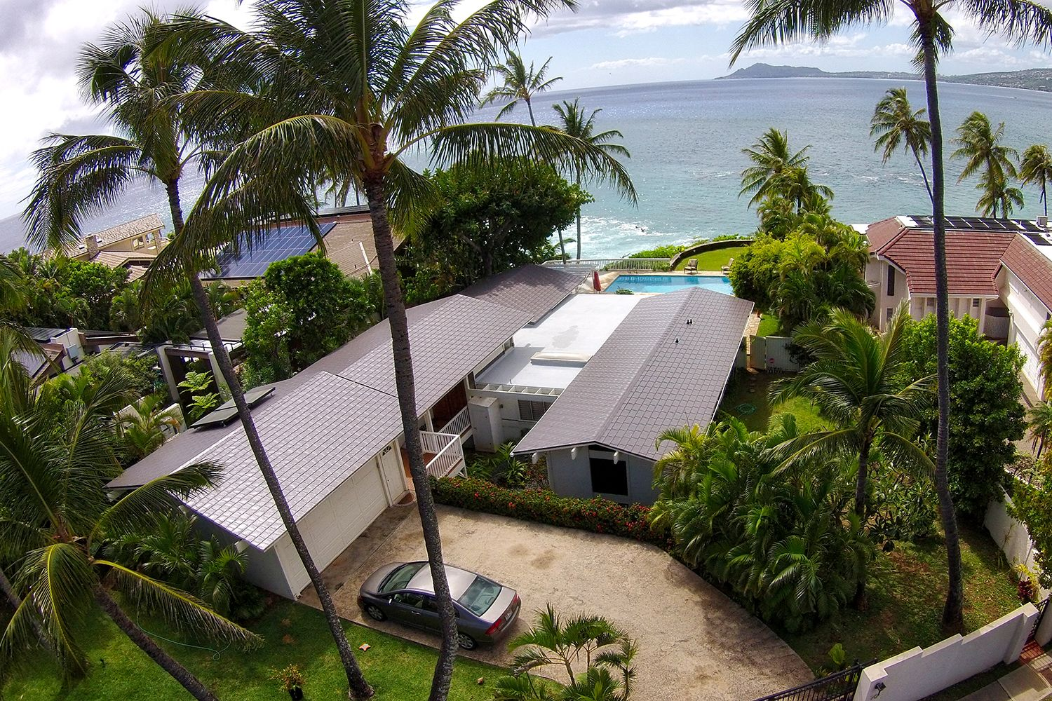 grey metal slate roof hawaii ocean beach palm trees