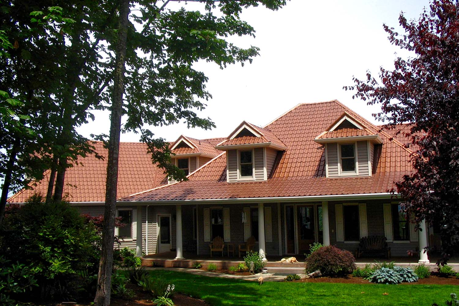 aged copper metal mediterranean tile roof dutch gable dormers