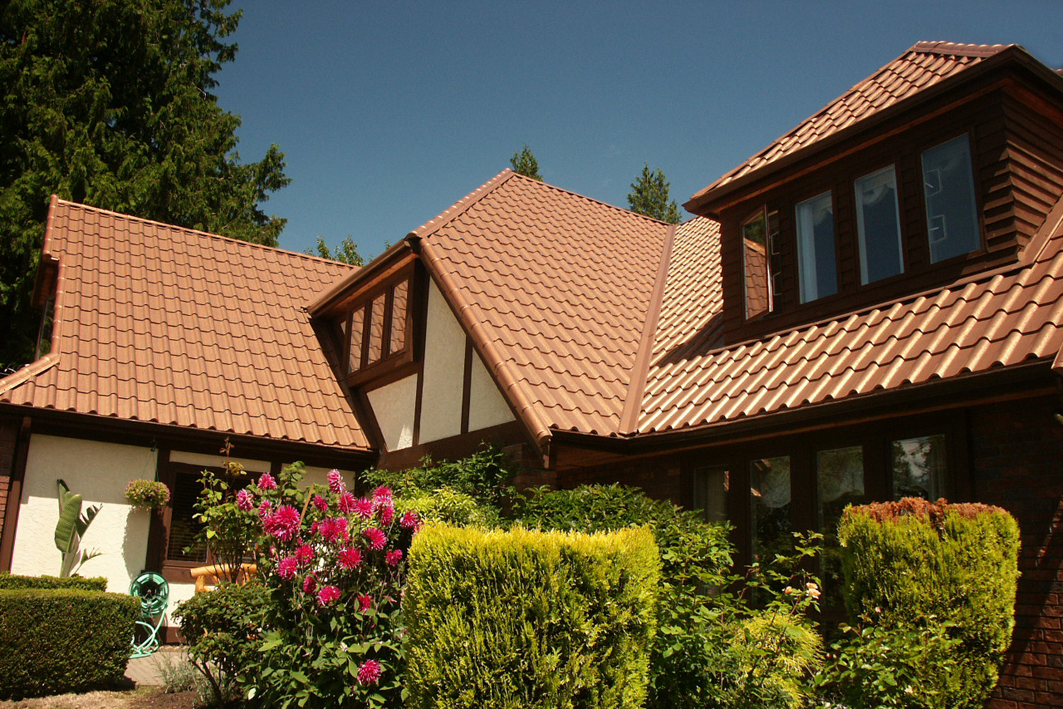 aged copper metal mediterranean tile roof shed roof tudor house