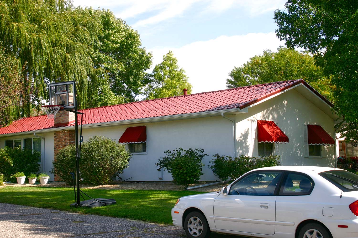 tile red metal mediterranean tile roof open gable rancher