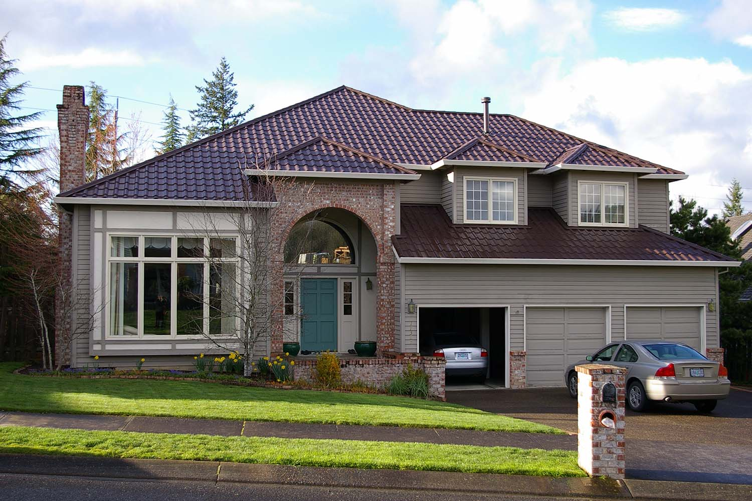 tudor brown metal mediterranean tile roof portland